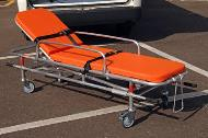 Main stretcher with restraints and mattress